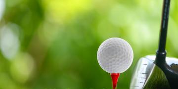 drive a golf ball on tee