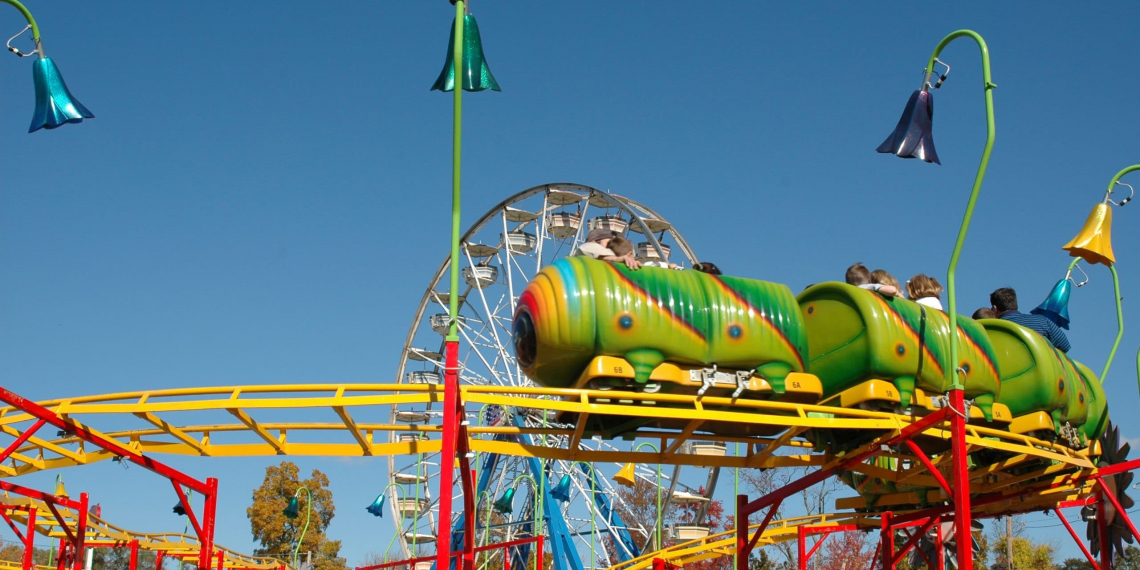 Brightly colored kiddie rides at a county fair