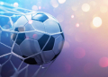 Soccer Ball in Goal on Multicolor Background