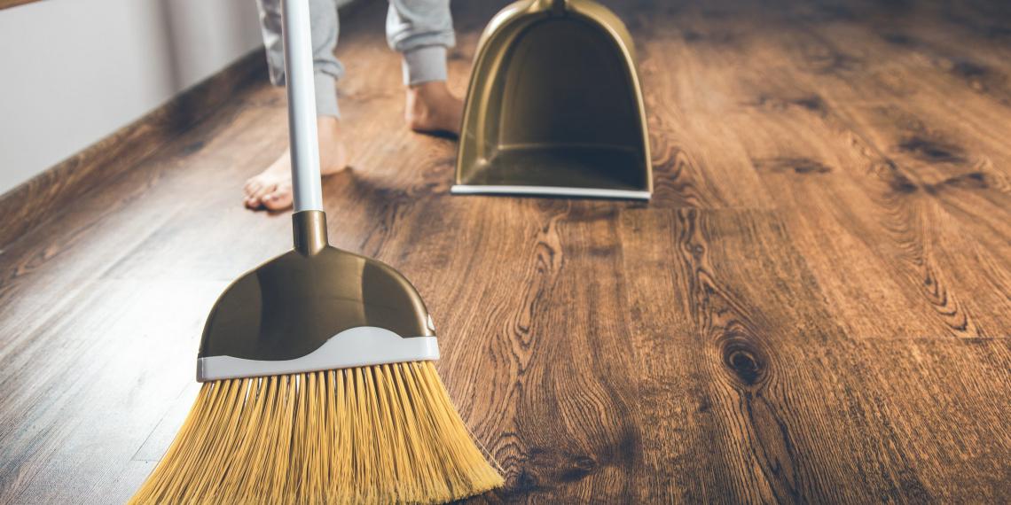 woman hand broom dustpan on the ground