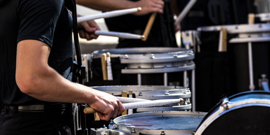 section of a marching band drum line performing