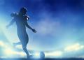 American football player kicking the ball, kickoff. Night stadium lights