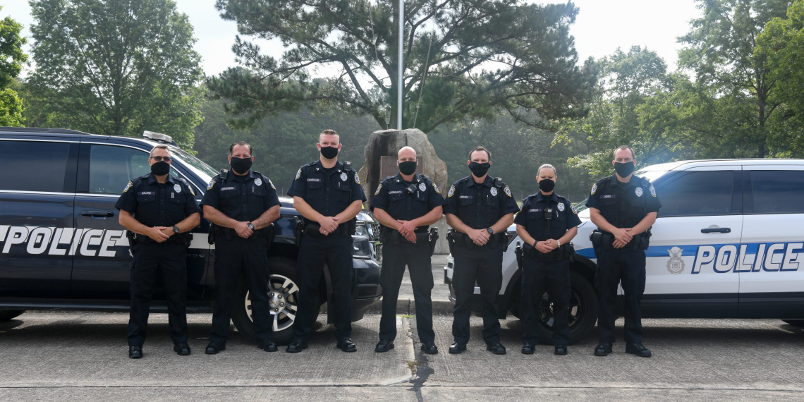Department of the Air Force civilian police officers pose for a photo, Sept. 2, 2020, at Arnold Air Force Base, Tenn. Pictured are, from left, Officer Todd Malone, Officer Bill Hernandez, Sgt. Andy Schwegler, Sgt. George Blasingame, Officer Josh Brown, Officer Jennifer Curbow and Officer Derek Jones. (U.S. Air Force photo by Jill Pickett)