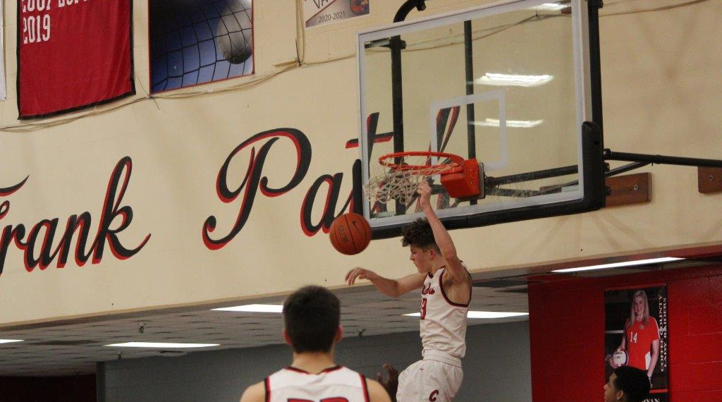 Trenton Scrivnor dunks the ball in a recent game
