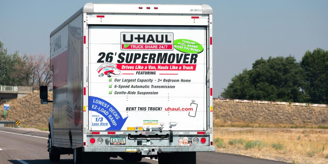 Rear view of U-Haul 26 ft moving truck travelling on the freeway. U-Haul is an American moving equipment and storage rental company - Phoenix, Arizona, USA - 2020