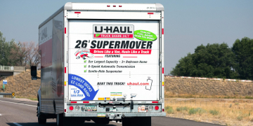 Rear view of U-Haul 26 ft moving truck travelling on the freeway. U-Haul is an American moving equipment and storage rental company - Phoenix, Arizona, USA - 2020