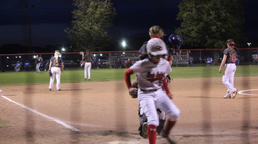 Olivia Evans scores a run in the District Championship game. Photo by Barry West